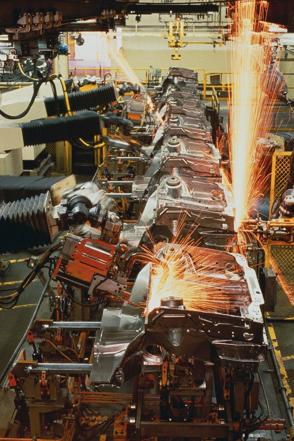 Robot Arms Welding Car Engines.