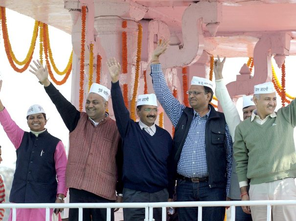 Aam Aadmi Party convener and new chief minister of Delhi Arvind Kejriwal (2L) and his ministers wave after taking their oaths of office. (AFP Photo)
