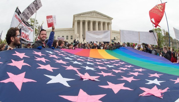 Pro-LGBT protesters hold a rainbow flag outside the Supreme Court building on April 25, 2015, countering the demonstrators who attended the March For Marriage in Washington, DC. PAUL J. RICHARDS / Getty Images