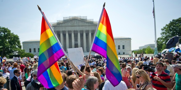 Image from Huffington Post. Hundreds of people gather outside the US Supreme Court building in Washington, DC on June 26, 2013 in anticipation of the  ruling on California's Proposition 8, the controversial ballot initiative that defines marriage as between a man and a woman. The US Supreme Court on Wednesday struck down a controversial federal law that defines marriage as a union between a man and a woman, in a major victory for supporters of same-sex marriage.The Defense of Marriage Act (DOMA) had denied married gay and lesbian couples in the United States the same rights and benefits that straight couples have long taken for granted. AFP PHOTO / MLADEN ANTONOV        (Photo credit should read MLADEN ANTONOV/AFP/Getty Images)
